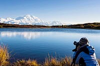 USA, Alaska, Mature woman taking photo of Mount Mckinley at Denali National Park