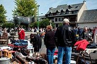 JUMBLE SALE AROUND THE BRONZE SCULPTURE OF THE AUBRAC BULL, A WORK BY GEORGES LUCIEN GUYOT, VILLAGE OF LAGUIOLE, AVEYRON 12, FRANCE