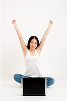 Chinese woman with arms raised