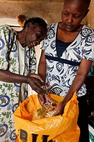 Food basket delivery provided by WOFAK Women Fighting Aids in Kenya, Kenya.