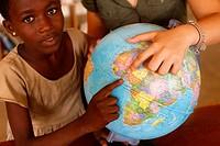 Schoolgirl with her sponsor, Togo.