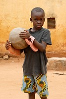 African boy holding a ball, Togo.