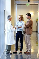 Doctor talking with the patient's family in the hospital corridor, Onkologikoa Hospital, Oncology Institute, Case Center for prevention, diagnosis and...