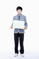 a male student with school uniform holding an empty white paper