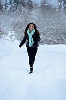 Young woman in snow, Upper Palatinate, Germany, Europe