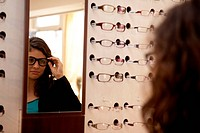 Woman at Optician, Selecting Eyeglass Frames.
