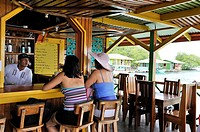 bar on stilts at Cayo Coral, southern headland of Bastimentos Island, Bocas del Toro Archipelago, Republic of Panama, Central America