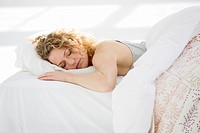 Attractive young woman sleeping in her bed