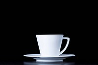 White coffee cup on black background