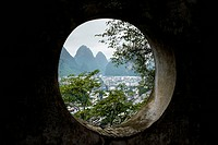 High angle view through a round window of Yangshuo, China.