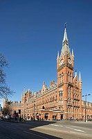 St Pancras Hotel, London, United Kingdom. Architect: Sir Giles Gilbert Scott with Richard Griffiths Arc, 2011. Distant corner view with clock tower an...