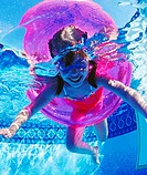 Underwater photograph of children, aged 5 and 7 years old, playing in swimming pool