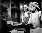 The British actress, singer and writer Julie Andrews (Julia Elizabeth Wells) and the American actress Mary Tyler Moore talking with the receptionist o...