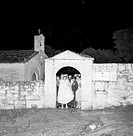The British banker George Ansley and her daughter Jacqueline Ansley in wedding dress trying to get to the entrance of the church where we will celebra...