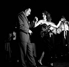 Smiling and well-dressed, American actress Abbe Lane, born Abigail Francine Lassman, performs a step of dance in Spanish musician Xavier Cugat's compa...