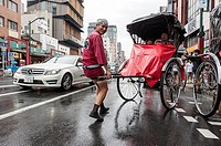 Man pushing a rickshaw on a rainy day, Tokyo, Japan, Asia
