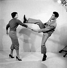 Italian dancer Bruno Dossena and one of his students showing some rock 'n roll dance steps. Italy, 1956.