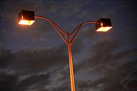 Street lights lit at night on a street in Florida USA