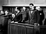 Italian actor and dubber Riccardo Cucciolla and Italian actor and scriptwriter Gian Maria Volonté standing in the dock in Sacco & Vanzetti. 1971. (Sac...