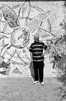 Russian-born French painter Marc Chagall (Moishe Segal) smiling in front of one of his mosaics in his villa, La Colline. Saint-Paul de Vence, Septembe...
