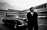 Portrait of Italian businessman Renato Bialetti smiling in front of his plant. Behind him, a car. Omegna, 1966.