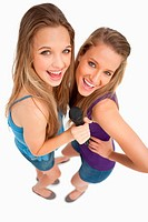 High_angle shot of two young beauty singing