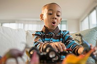African American boy playing with toys
