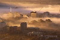 Morning fog hanging over the center of the city, Canberra, Australian Capital Territory