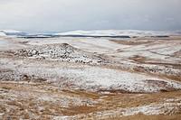 Rolling hills in snowy landscape