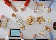 Overhead view of people having tea