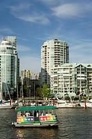 Tourists riding in the aquabus harbour tour boat, Granville Island, Vancouver, British Columbia, Canada