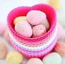 an image for Easter, candy eggs and hearts, colourful and fresh