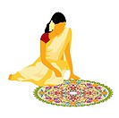 Woman making rangoli on the floor