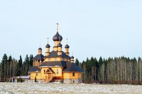 The wooden church against winter wood. Belarus