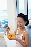 Girl with a bowl of chips