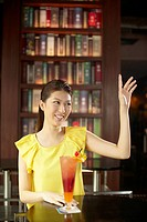 Woman raising her arm to order food