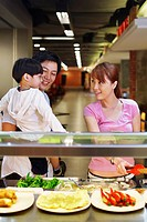 Family choosing food at the food court