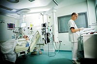Reportage in Robert Ballanger hospital's Intensive Care Unit in France. A nursing auxiliary in a patient's room.