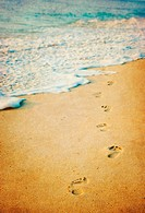 grunge image of footprints in a tropical beach