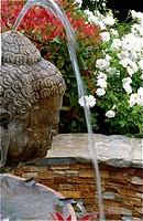 Buddha sculpture in fountain, Beverly Hills, California, USA