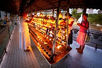 Sri Lanka - Pilgrims light up candles in the Temple of the Tooth, UNESCO World Heritage Site, Buddhist shrine, Kandy, Sri Dalada Maligawa, central reg...