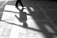 Pedestrian and his shadow, Patriarca square, Valencia, Spain
