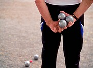 Men and women playing boules in town or city parks across Europe