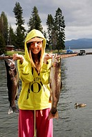 13 year old girl showing off the 5 lb. and 3 lb. rainbow trout she caught at Diamond Lake in Oregon