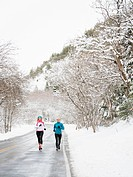 Two women jogging in winter