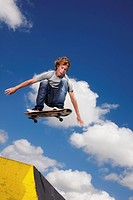 Young man on skateboard jumping