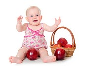 The little baby with red apples