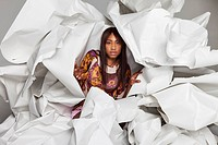 Portrait of young woman in paper