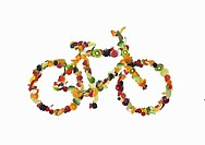 A bicycle shaped out of fruits