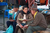 Quechua people talking on a small market, Ecuador
